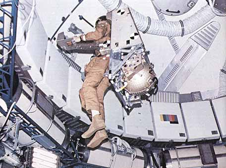 An astronaut maneuvering unit, shown here, was flown in the workshop to test it under weightless conditions for possible future application.