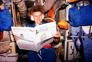 View of astronaut Shannon Lucid reading a St. Petersburg paper in the Mir space station Base Block.
