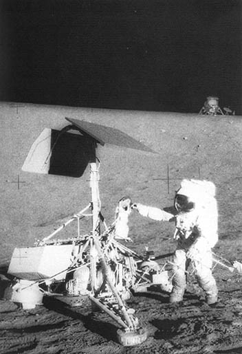 Astronaut Charles Conrad, Jr., examines Surveyor 3 on the Moon.
