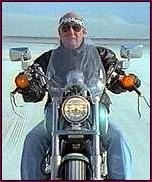 Pete Conrad on his motorcycle